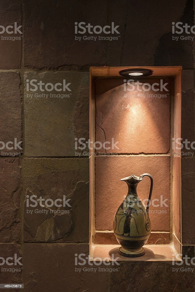 Grecian pitcher in lighted art niche royalty-free stock photo
