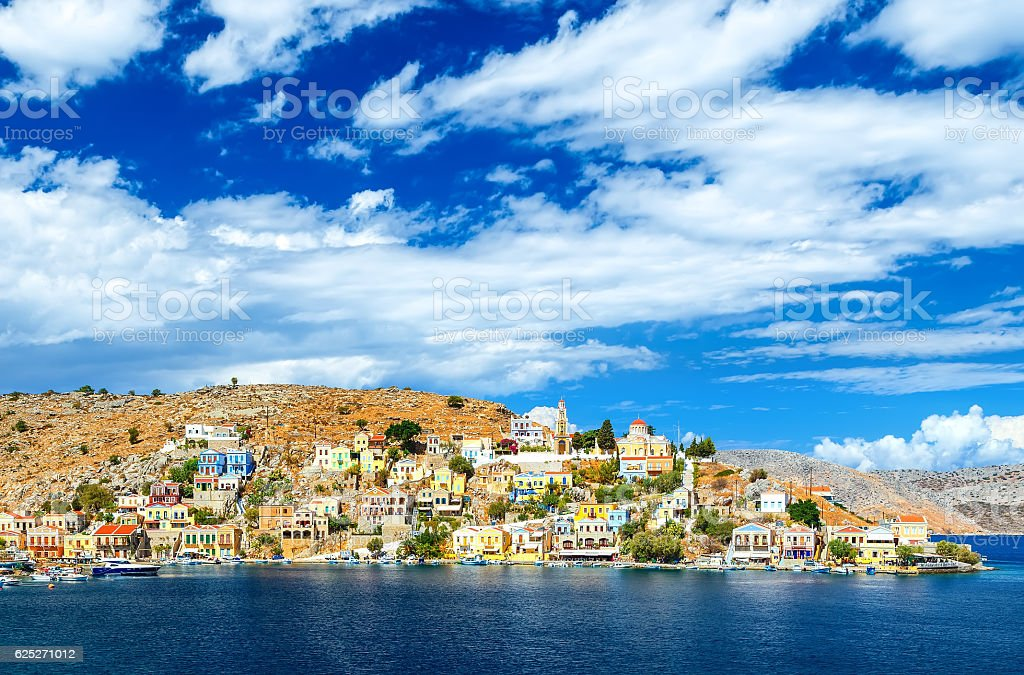 Greece. Dodecanesse. Island Symi Simi . Colorful houses on rocks stock photo