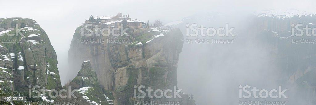 Greece. Meteora monastery in a winter fog. Panorama. royalty-free stock photo