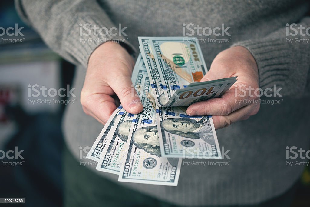 greed for money, background of the money, dollars stock photo