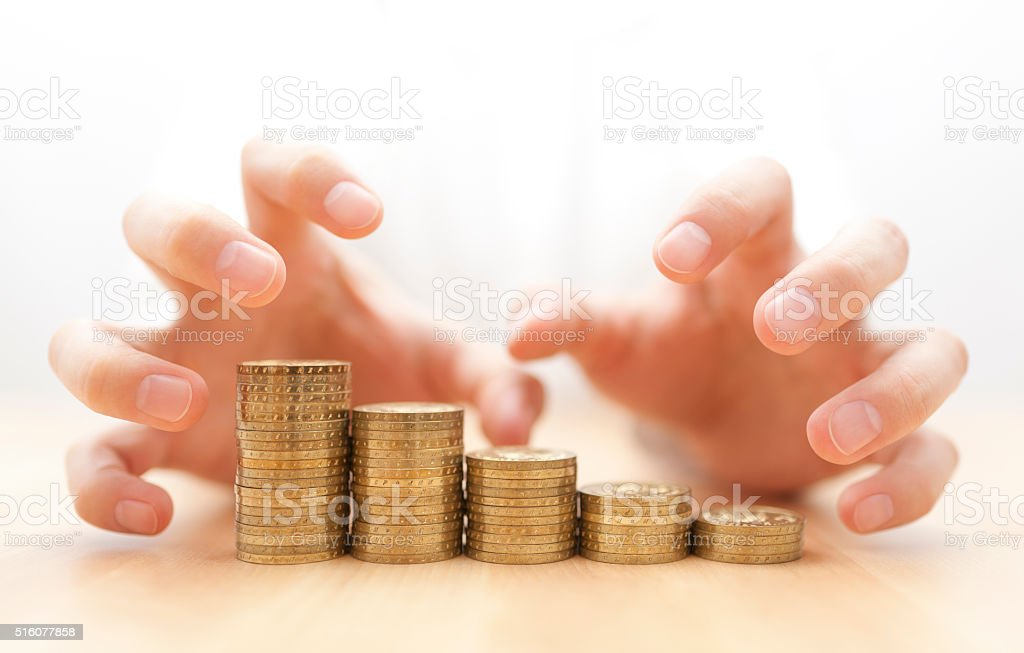 Greed for money. Hands grabbing coins. stock photo