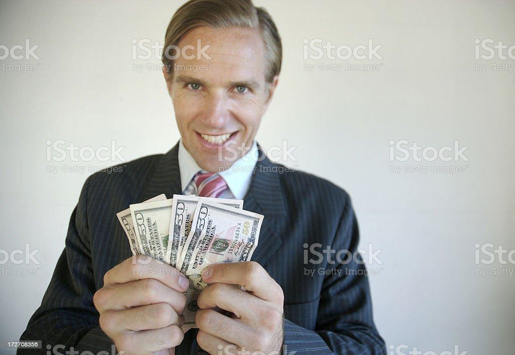 Greedy Businessman Holds a Stack of 50 Dollar Bills Money royalty-free stock photo