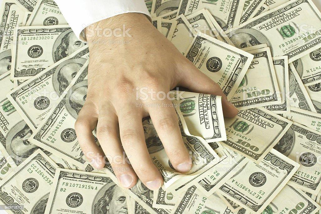 Greedy hand grabs money royalty-free stock photo