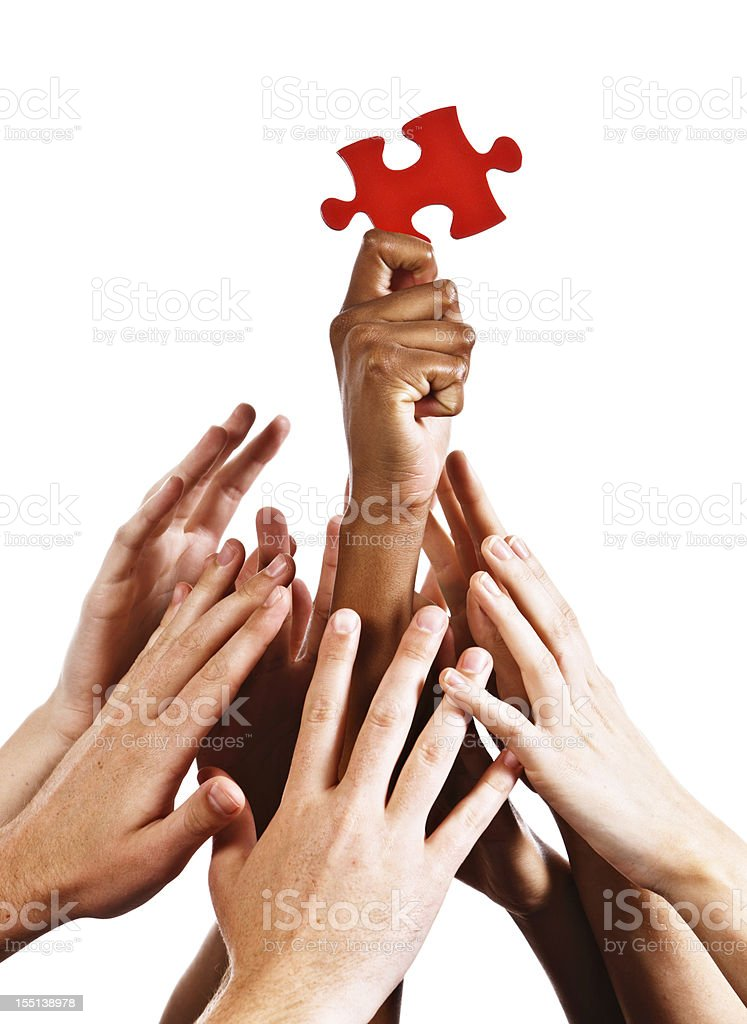 Greedy hands seek the answer grabbing for single puzzle piece royalty-free stock photo