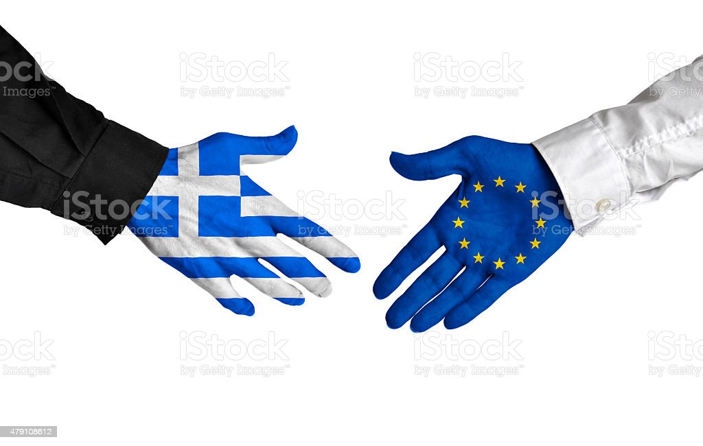 Greek and European Union leaders shaking hands on deal agreement stock photo