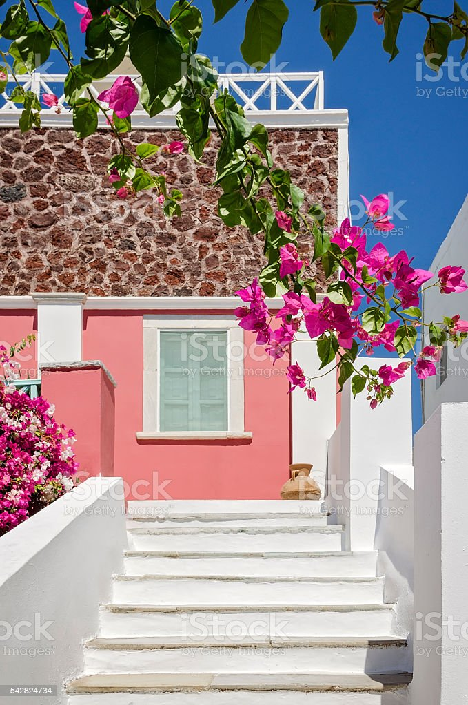 Greek architecture of the streets with white stairs, Santorini Greece stock photo