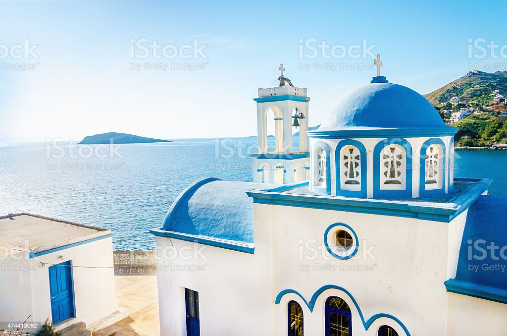 Greek blue dome of white church, Greece stock photo