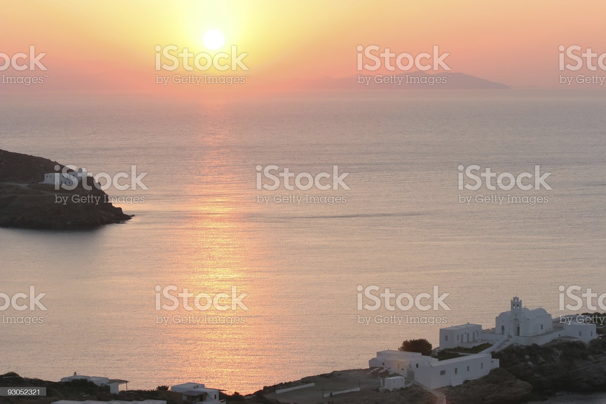 Greek coast with old church at sunrise royalty-free stock photo