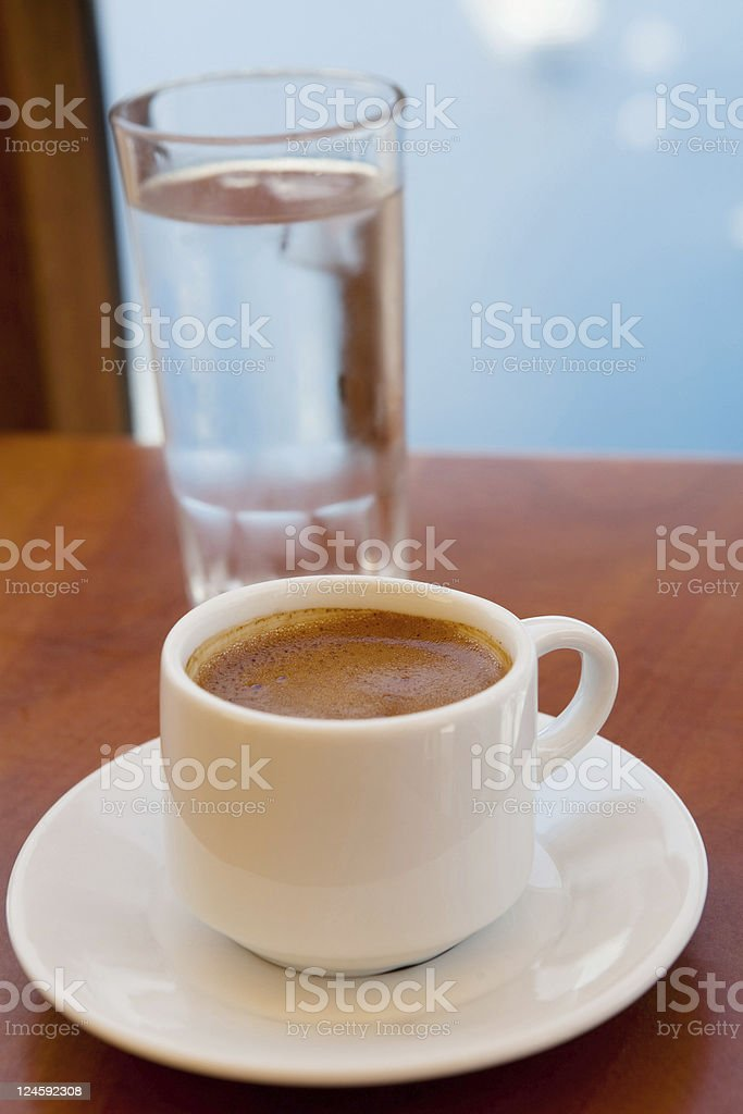 Greek coffee and a glass of water royalty-free stock photo