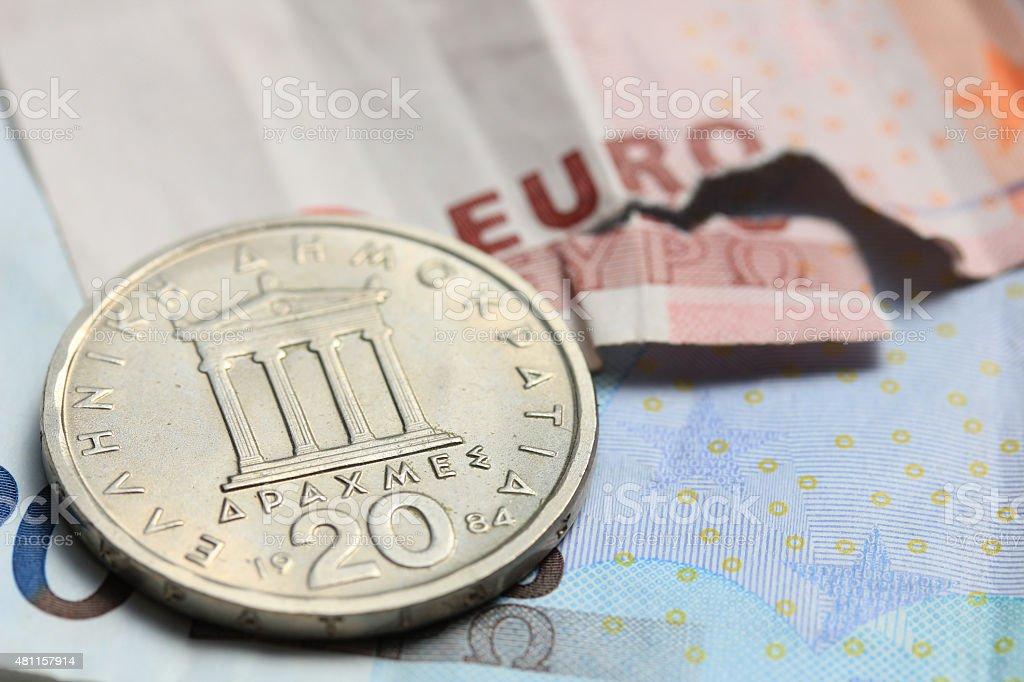 Greek coins on euro notes stock photo