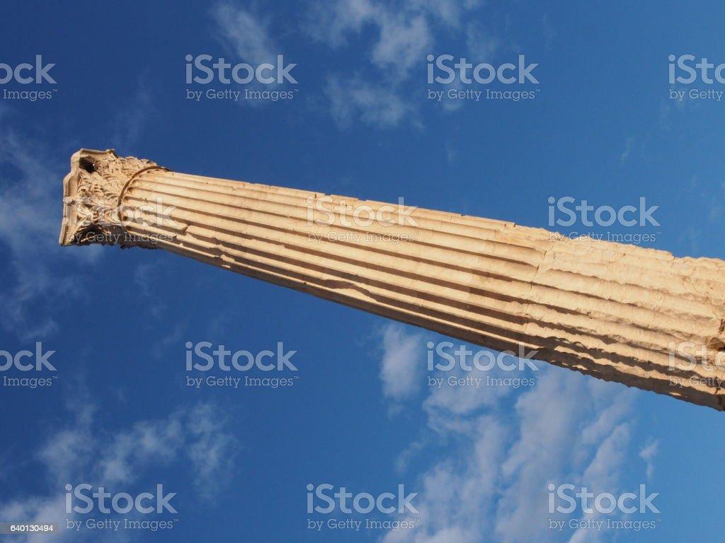 Greek column reaching into the sky stock photo