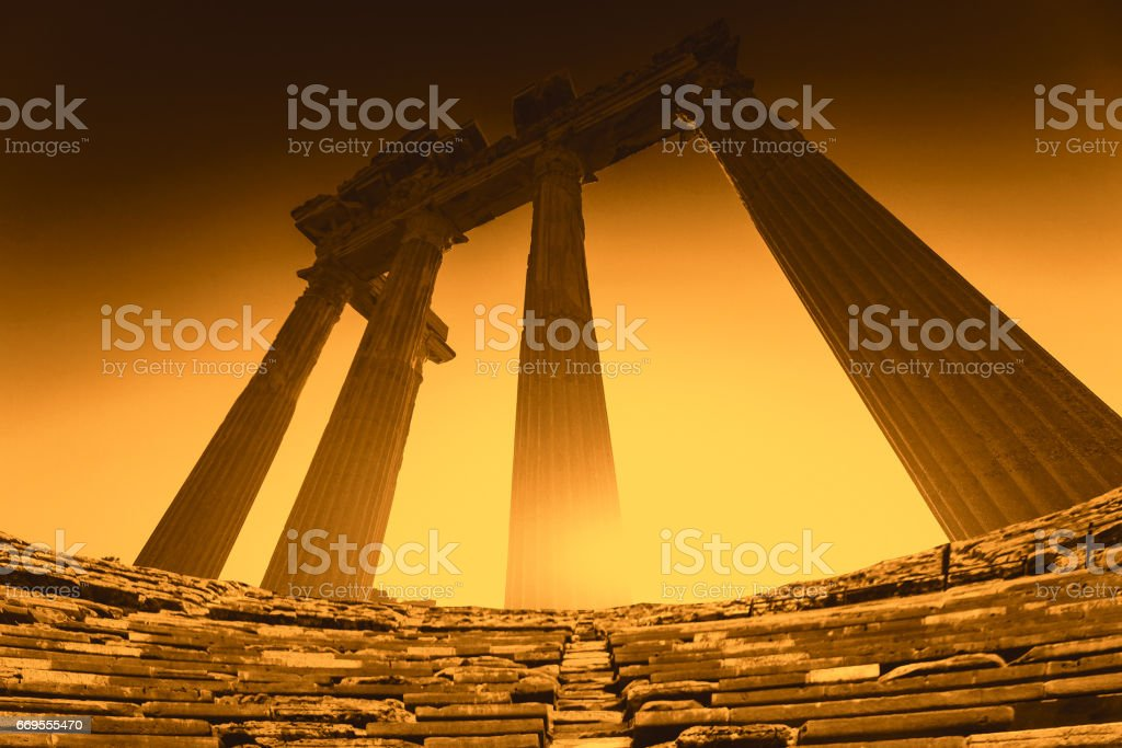 Greek columns on the ruins of a temple in Side at sunset stock photo