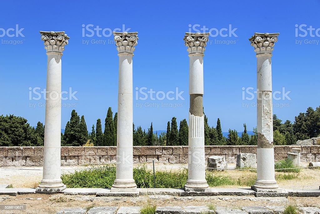 Greek columns or pillars under blue sky stock photo