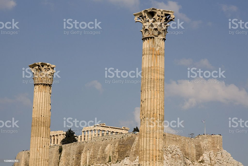 Greek corinthian columns against Acropolis - Athens royalty-free stock photo