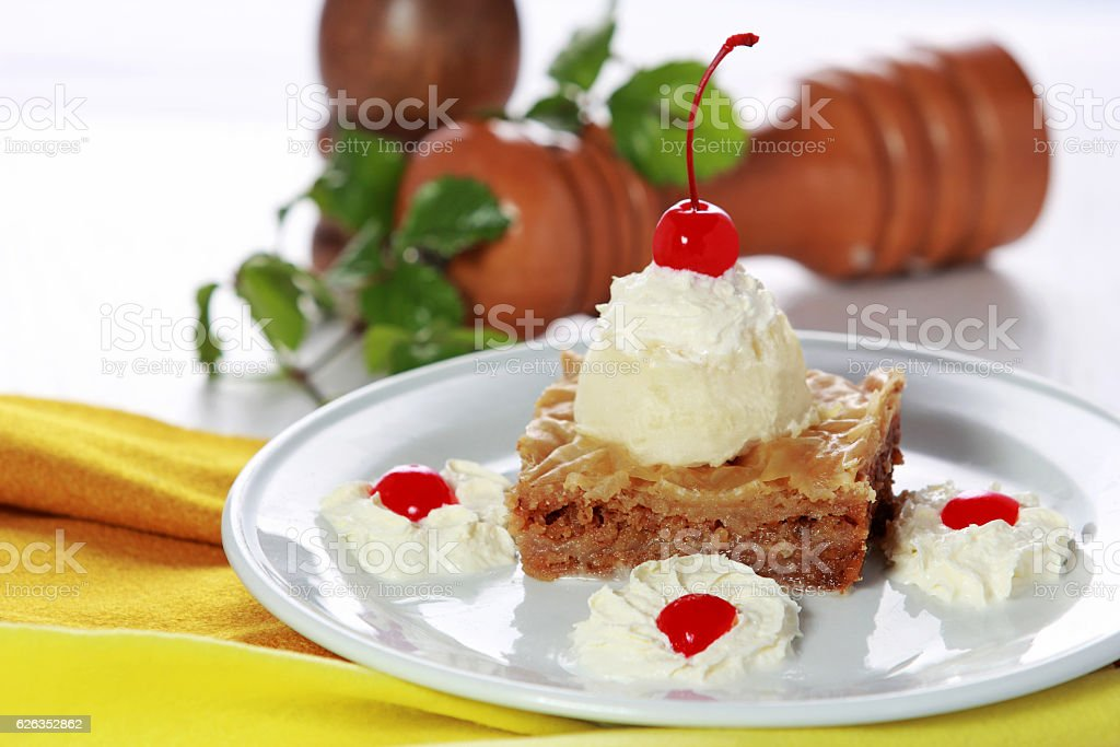 Greek dessert Baklava served with vanilla ice cream stock photo