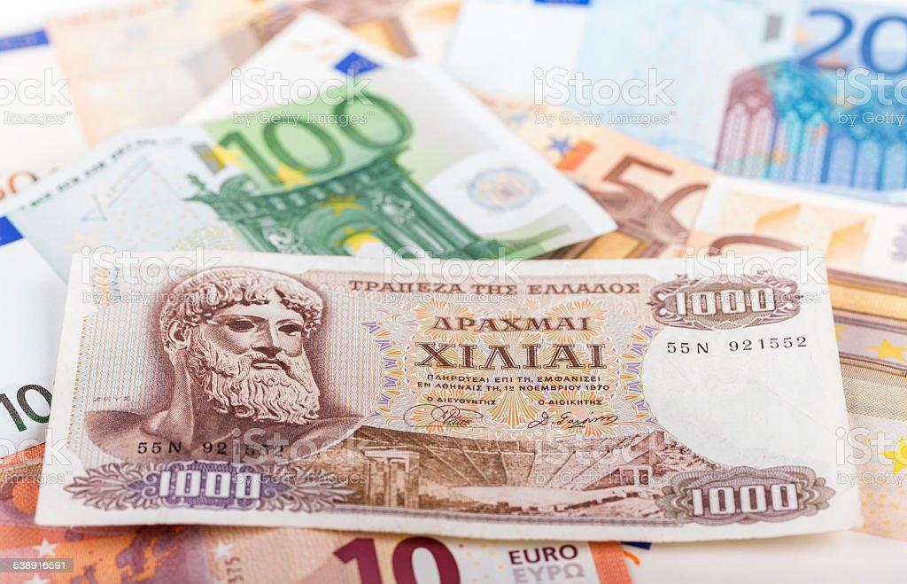 Greek Drachma lying on euro bills stock photo