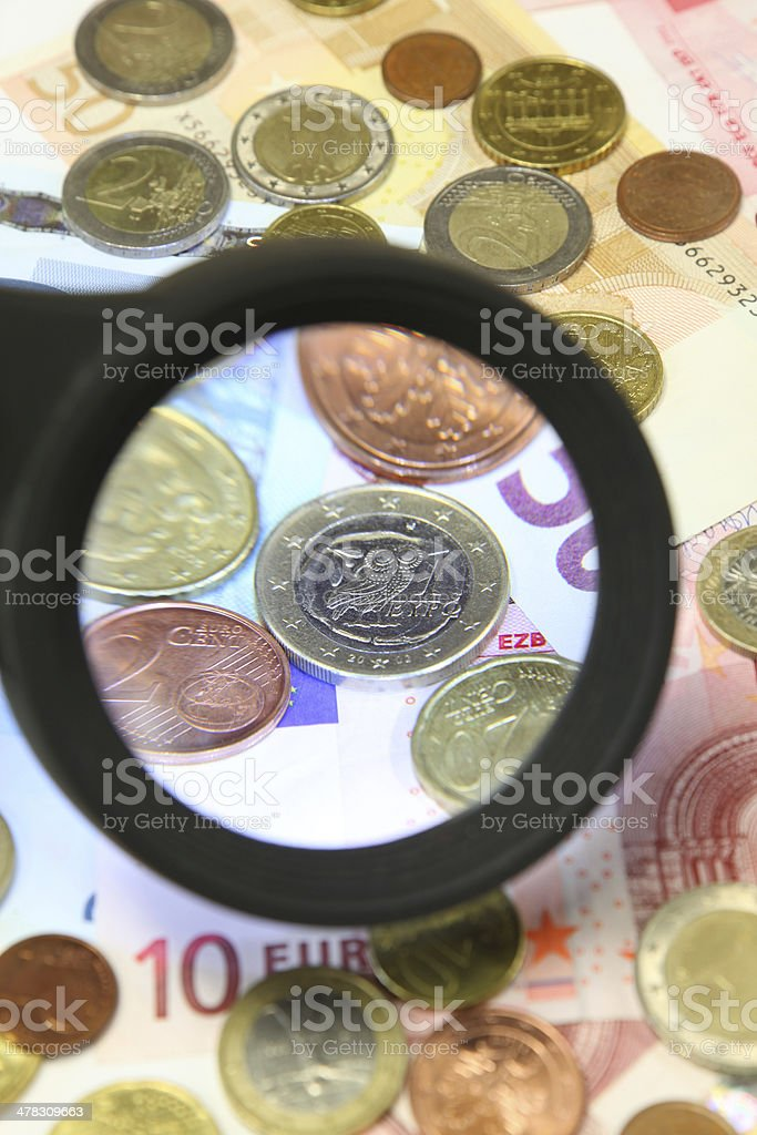 Greek Euro under a Magnifying Glass royalty-free stock photo