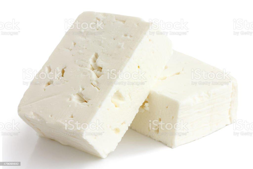 Greek feta cheese block isolated on white. stock photo