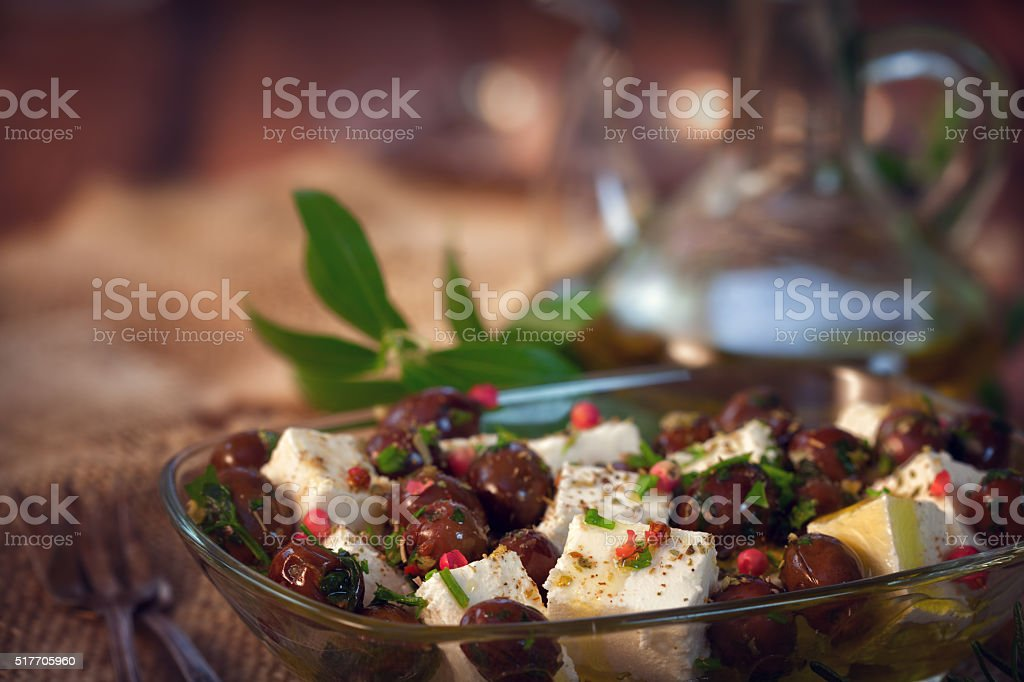 Greek Feta cheese with black olives - healthy appetizer stock photo
