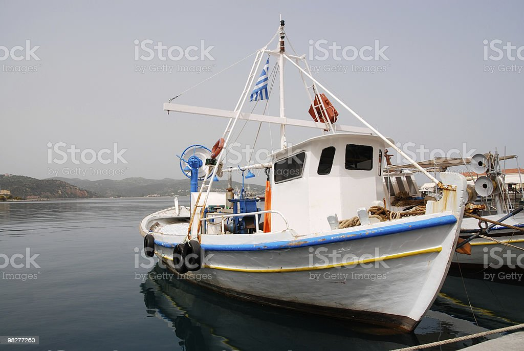 Greek fisherboat wtih flag royalty-free stock photo
