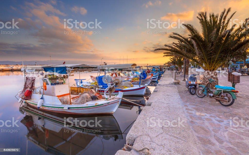 Greek Fishing boats harbor scene stock photo