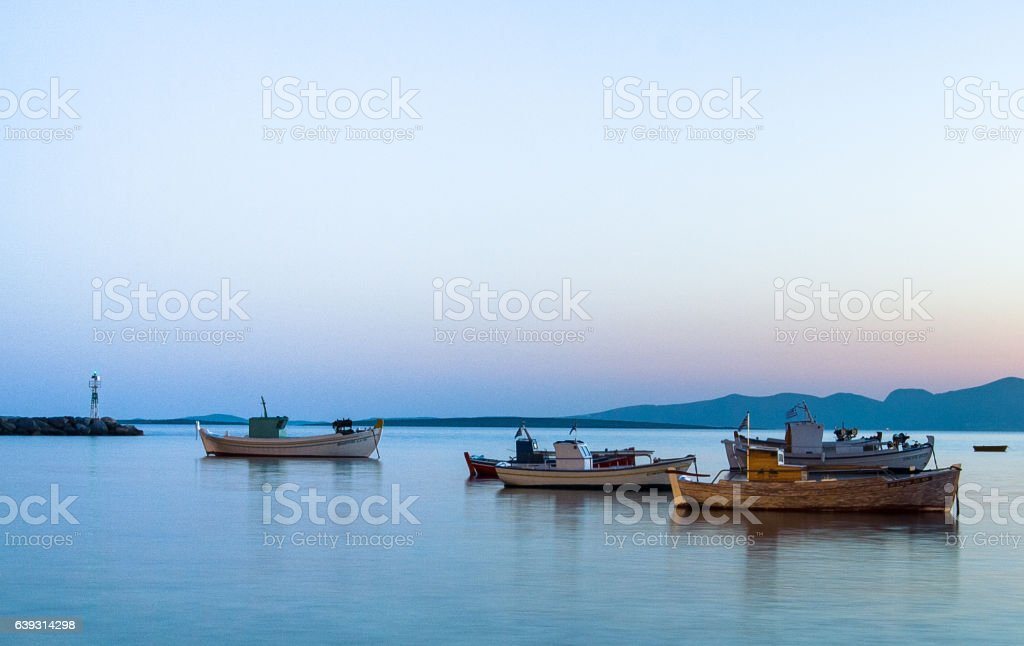 Greek fishing boats in harbor at sunset, Aliki, Paros, Cyclades stock photo