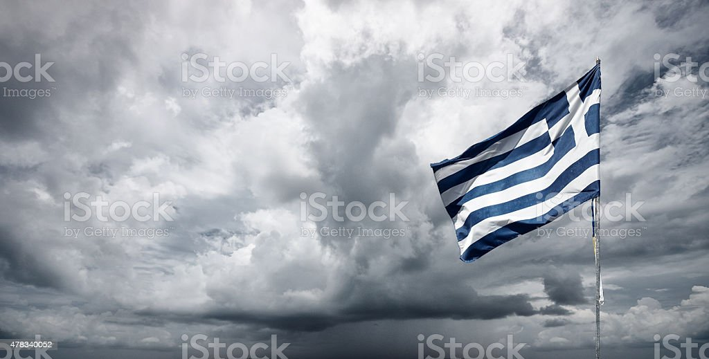 Greek Flag And Stormy Skies stock photo