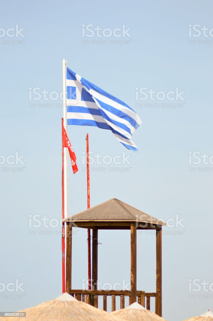 Greek flag floating on a white mat stock photo