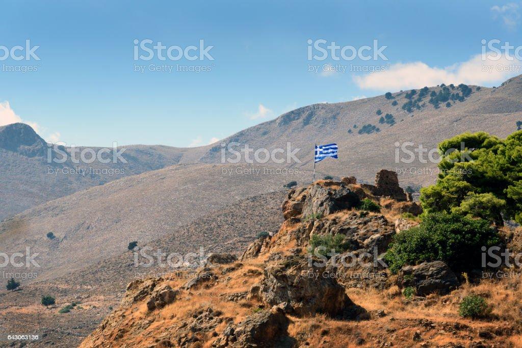 Greek flag on hill near Chora Sfakion town, Greece stock photo