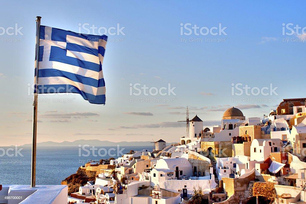 Greek Flag over Oia stock photo