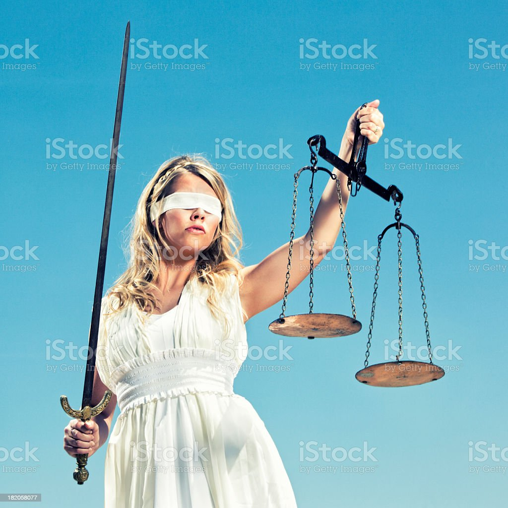 Greek goddess Themis with a sword and a justice scale stock photo