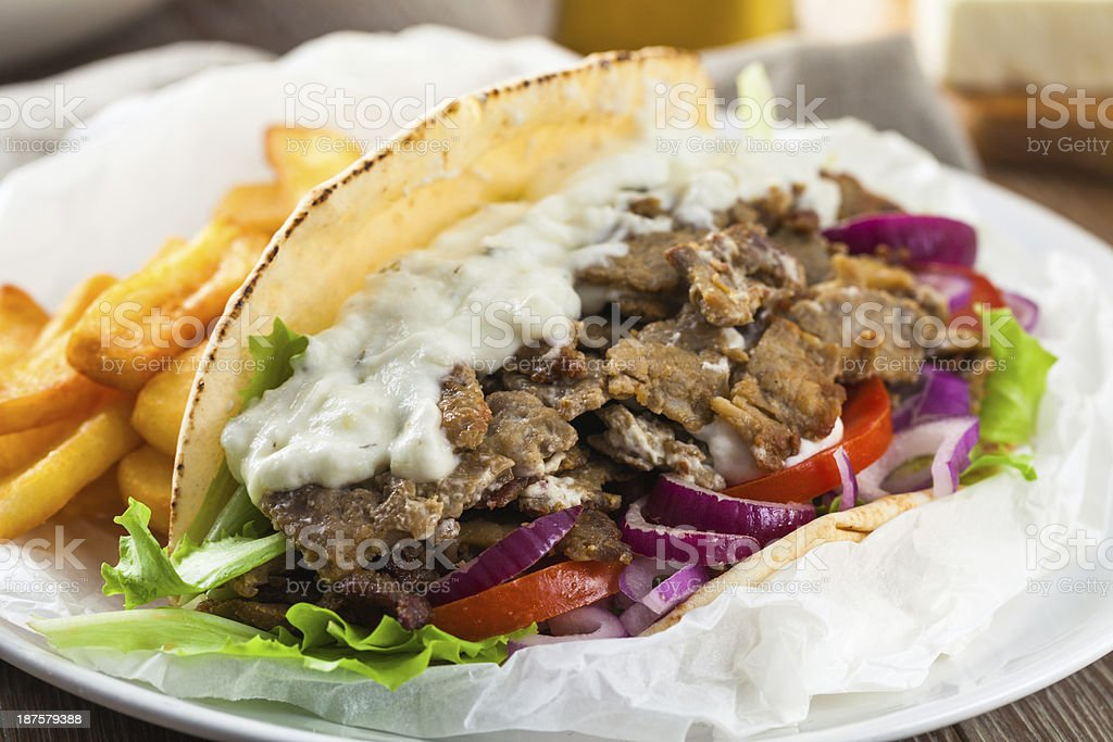 Greek Gyros with Fries and Salad royalty-free stock photo