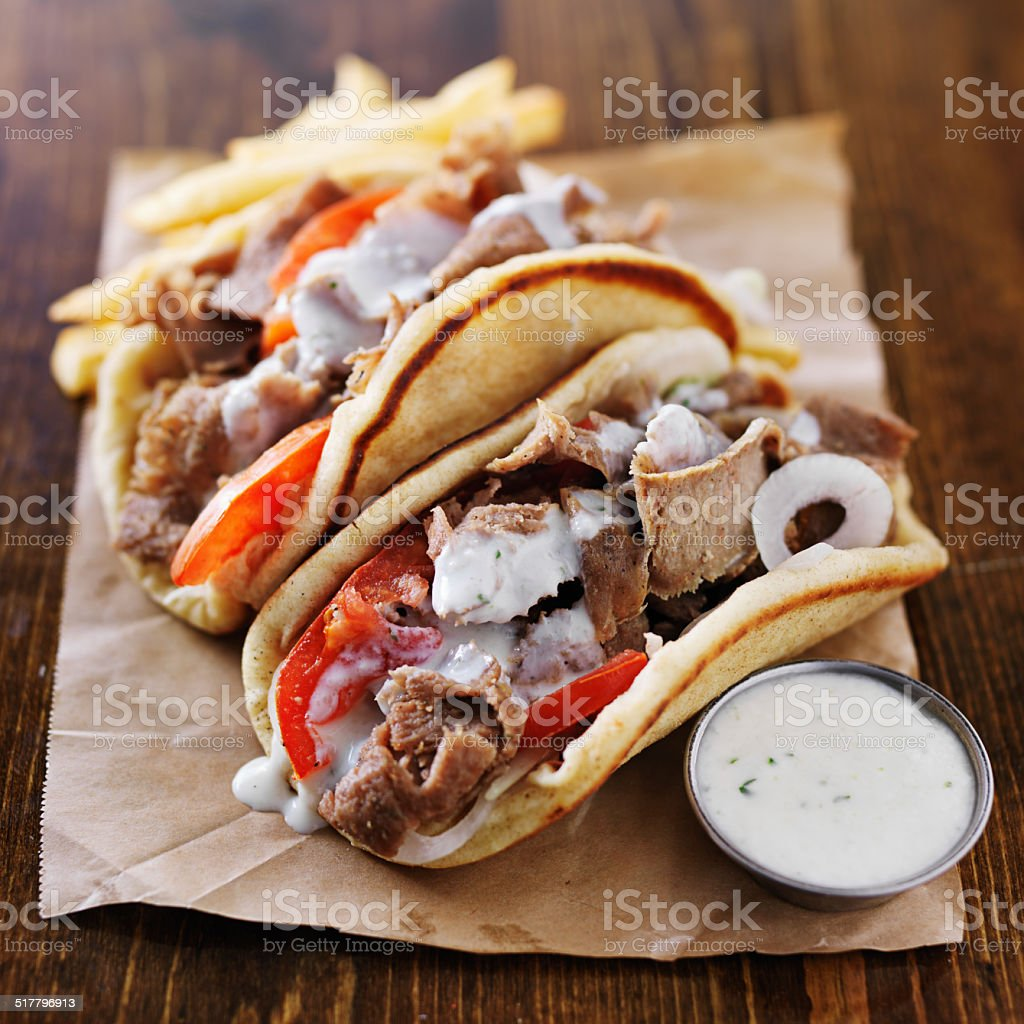 greek gyros with tzatziki sauce stock photo