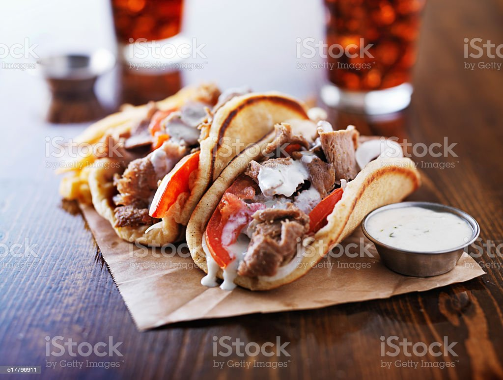 greek gyros with tzatzikii sauce and fries stock photo