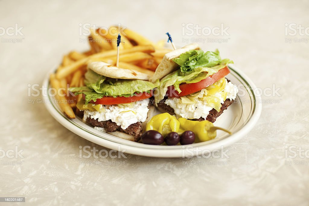 Greek Hamburger with French Fries royalty-free stock photo