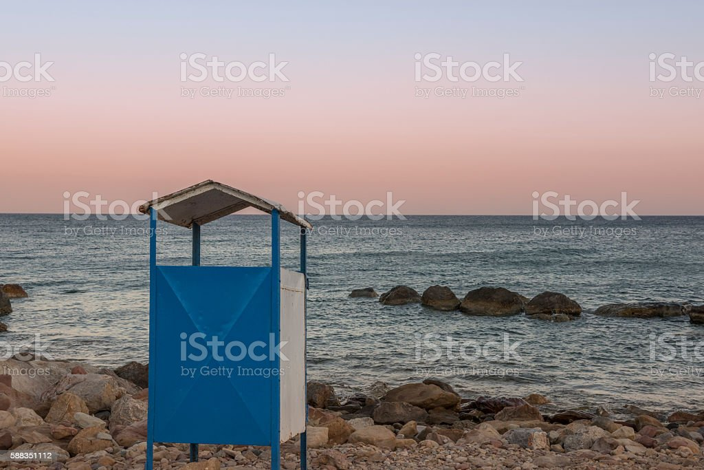 Greek Island beach changing box at sunset stock photo