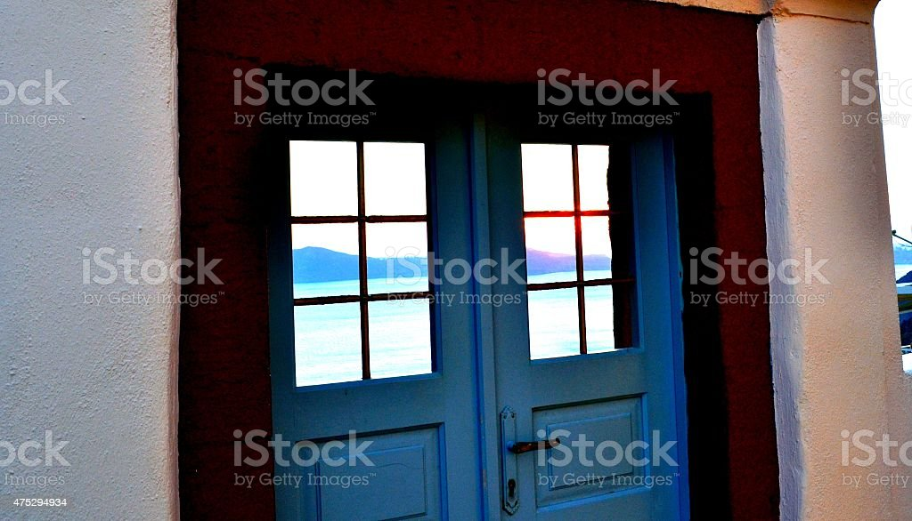 Greek island. Santorini, a colored door on seascape stock photo