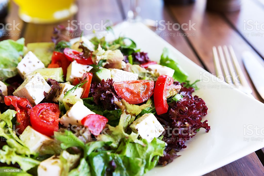 Greek Mediterranean salad with feta cheese, olives and peppers stock photo
