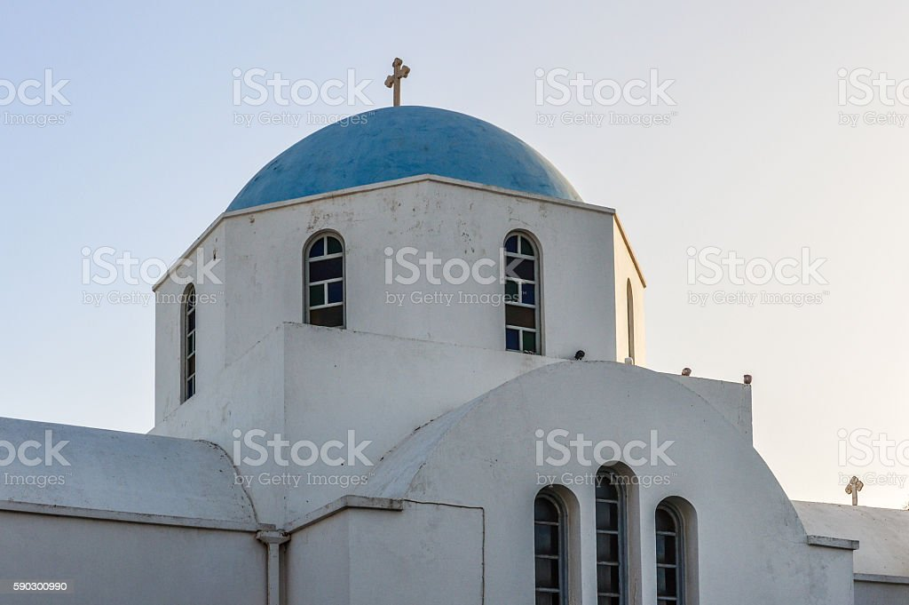 Greek Orthodox church during sunset on the Greek Isles stock photo