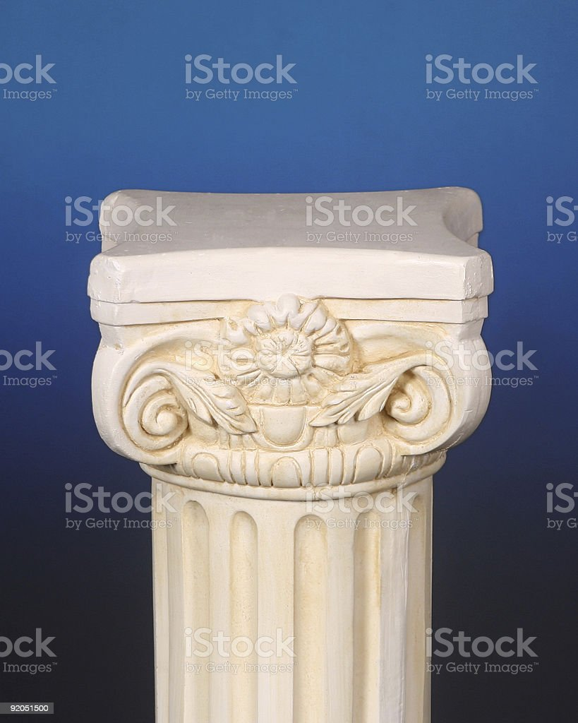 Greek pedestal on a blue background royalty-free stock photo