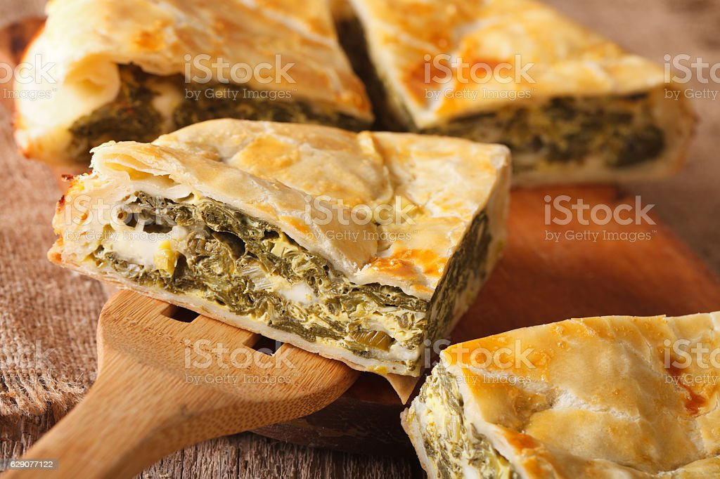 Greek pie with spinach and cheese spanakopita close-up. horizontal stock photo