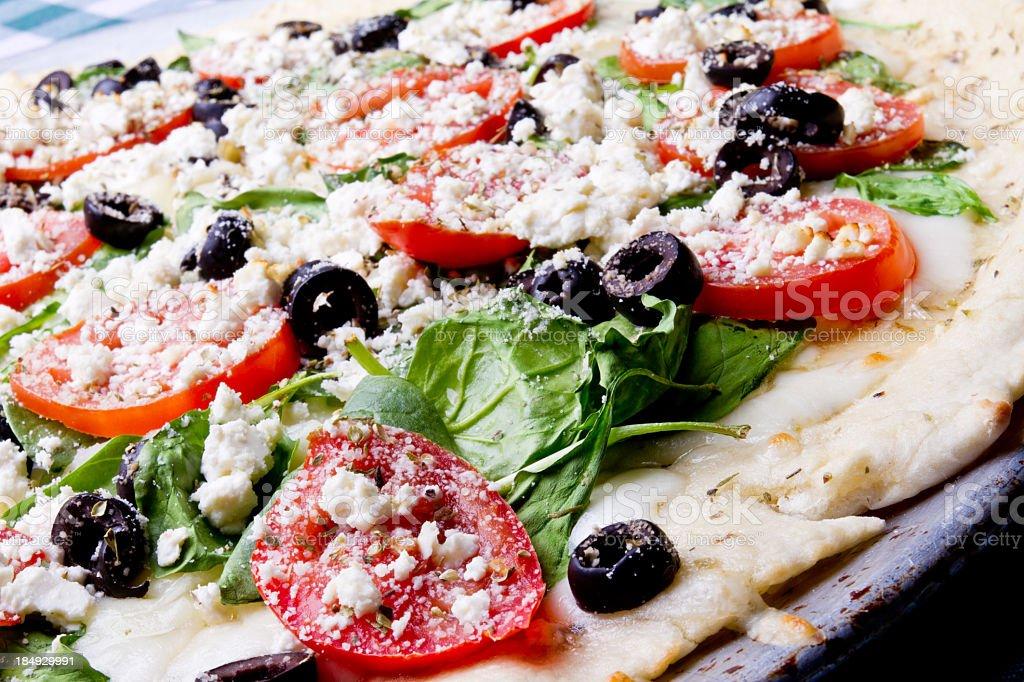 Greek Pizza on Green Gingham stock photo
