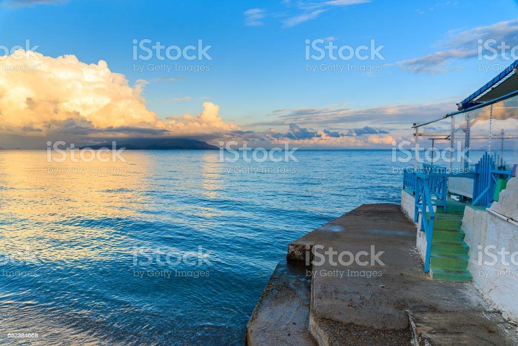 Greek restaurant on beach at sunset time, Samos island, Greece stock photo