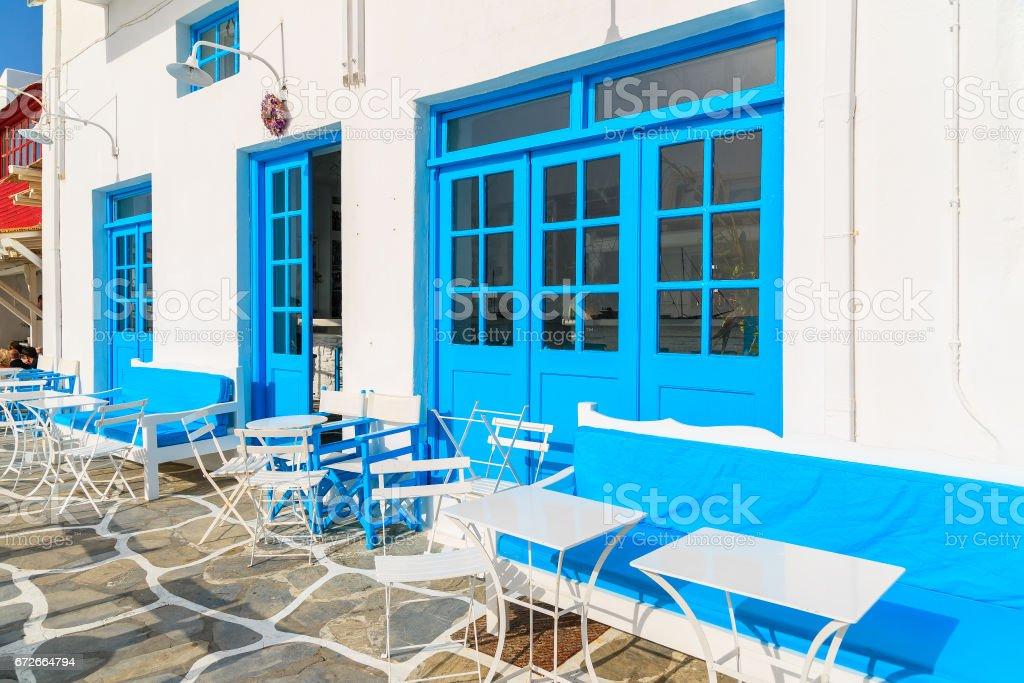 Greek restaurant with blue doors and windows in Little Venice part of Mykonos town, Mykonos island, Greece stock photo