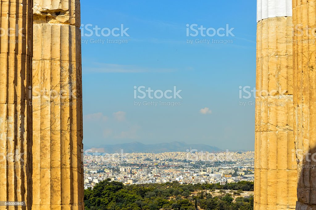 Greek ruins with Athens cityscape stock photo