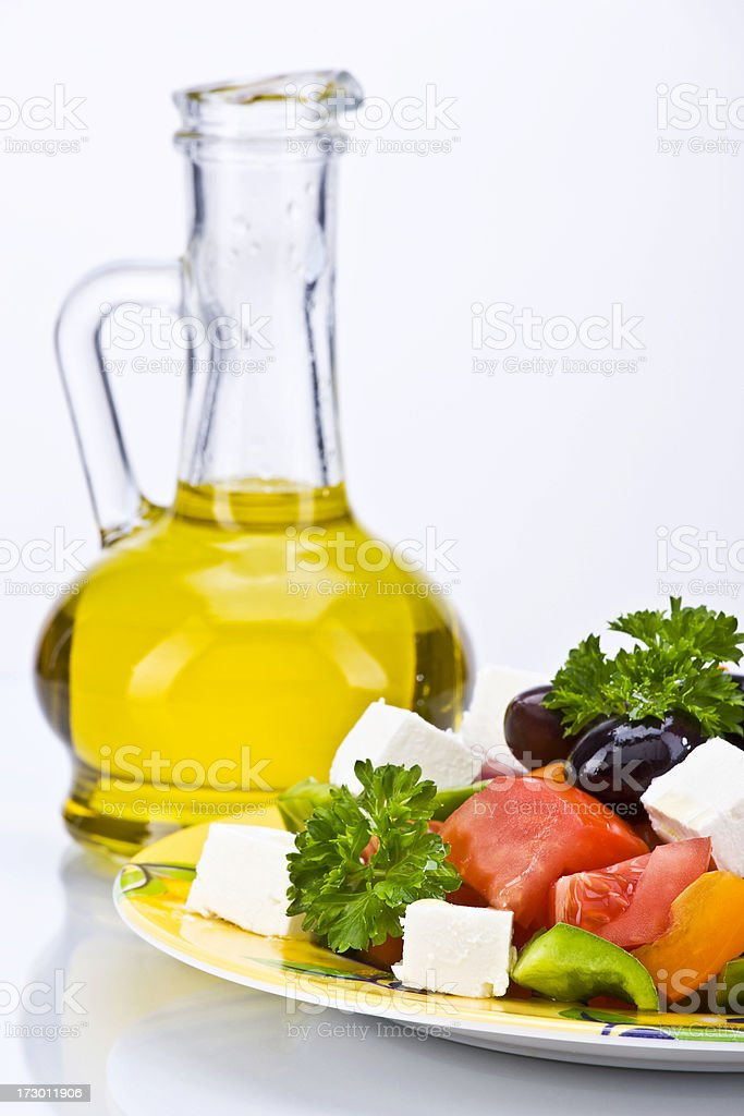 Greek Salad and Olive Oil in Bottle royalty-free stock photo