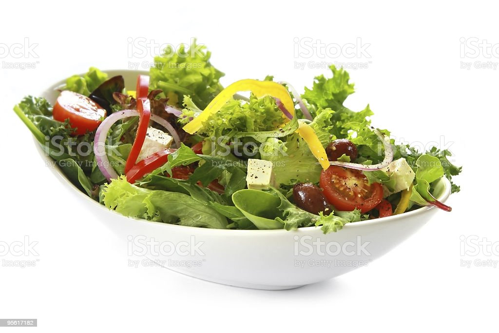 A Greek salad in a bowl on a white background stock photo