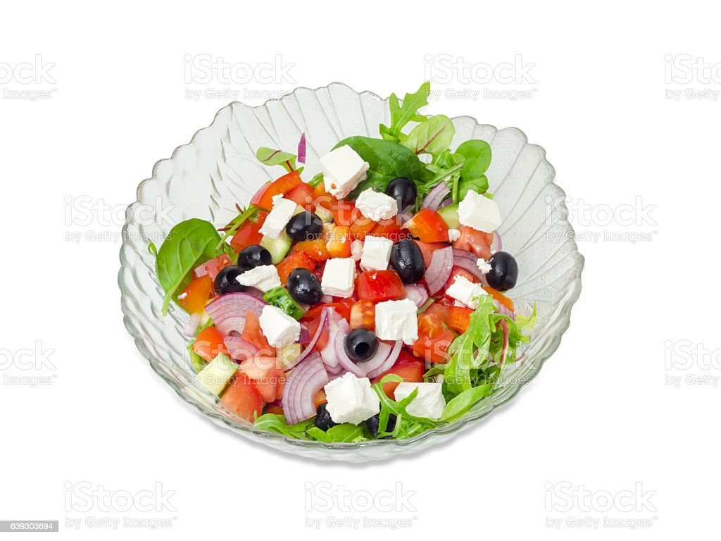 Greek salad in a glass salad bowl stock photo
