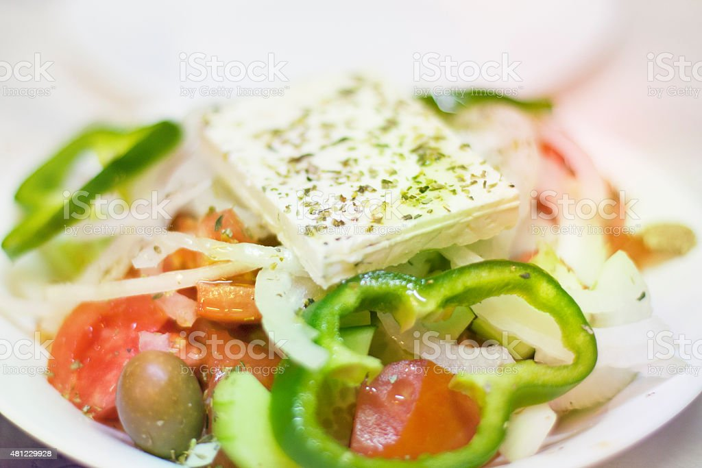 Greek salad in plate closeup stock photo