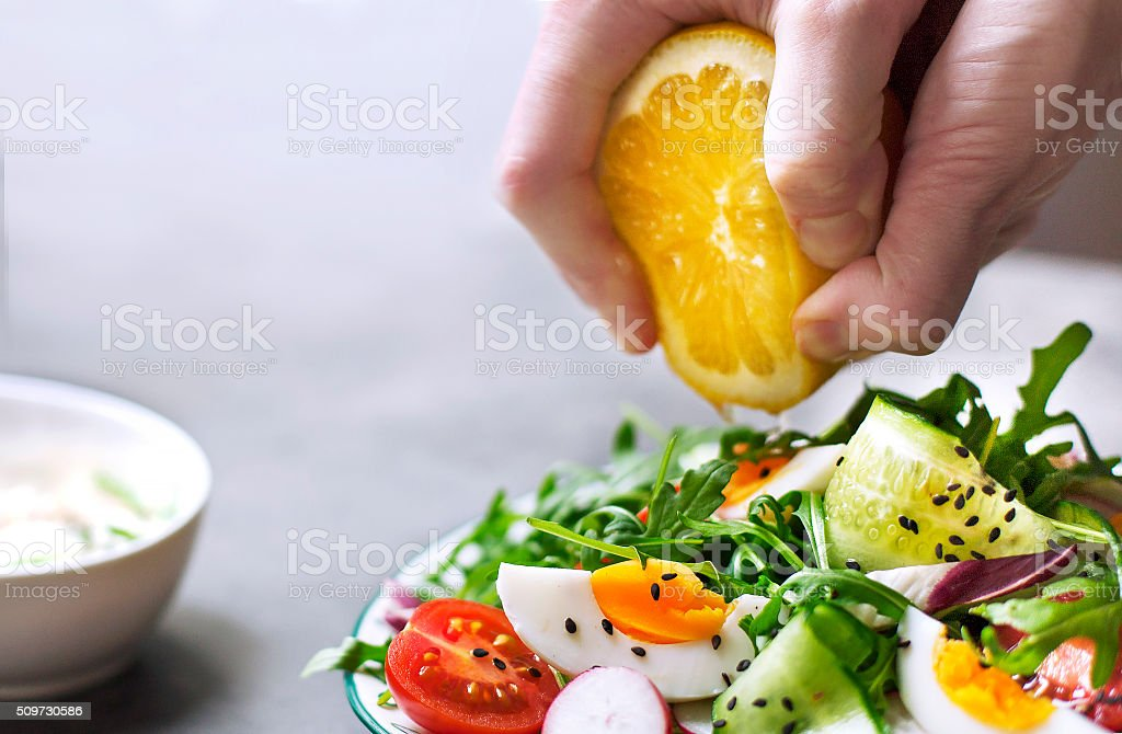 Greek salad in red boul stock photo